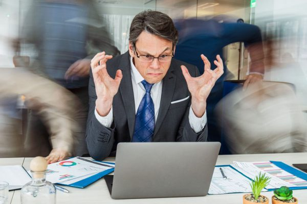 frustrated man viewing laptop